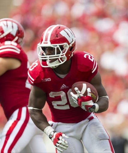 Sep 7, 2013; Madison, WI, USA; Wisconsin Badgers running back James White (20) during the game against the Tennessee Tech Golden Eagles at Camp Randall Stadium.  Wisconsin won 48-0.  Mandatory Credit: Jeff Hanisch-USA TODAY Sports