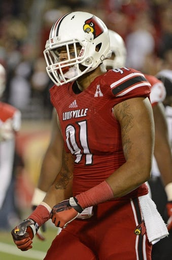 Nov 16, 2013; Louisville, KY, USA; Louisville Cardinals defensive end Marcus Smith (91) and reacts after a defensive stop during the second half of play against the Houston Cougars at Papa John's Cardinal Stadium. Louisville defeated Houston 20-13.  Mandatory Credit: Jamie Rhodes-USA TODAY Sports