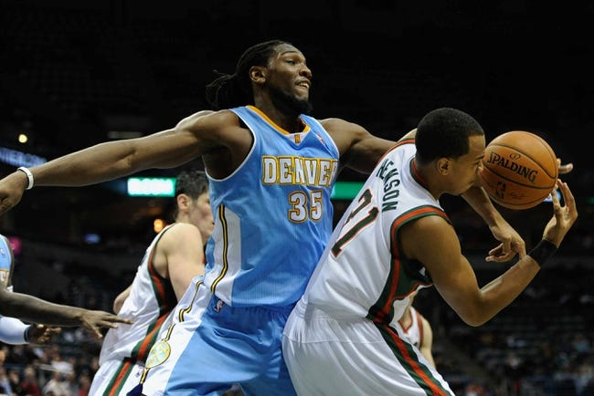 Feb 20, 2014; Milwaukee, WI, USA; Denver Nuggets forward Kenneth Faried (35) and Milwaukee Bucks center John Henson (31) fight for a rebound in the 2nd quarter at BMO Harris Bradley Center. Mandatory Credit: Benny Sieu-USA TODAY Sports