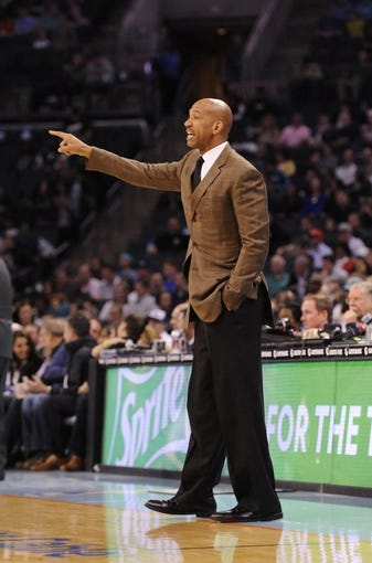 Feb 21, 2014; Charlotte, NC, USA; New Orleans Pelicans head coach Monty Williams during the first half of the game against the Charlotte Bobcats at Time Warner Cable Arena. Mandatory Credit: Sam Sharpe-USA TODAY Sports