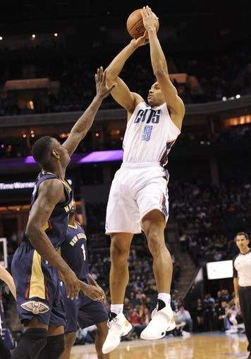 Feb 21, 2014; Charlotte, NC, USA; Charlotte Bobcats guard Gerald Henderson (9) shoots a jump shoot during the first half of the game against the New Orleans Pelicans at Time Warner Cable Arena. Mandatory Credit: Sam Sharpe-USA TODAY Sports