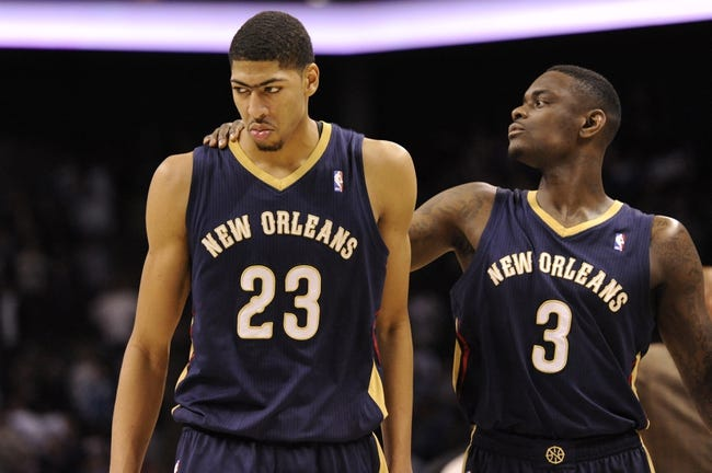Feb 21, 2014; Charlotte, NC, USA; New Orleans Pelicans forward center Anthony Davis (23) reacts beside guard Anthony Morrow (23) after fouling out of the game during the second half against the Charlotte Bobcats at Time Warner Cable Arena. The Bobcats won 90-87. Mandatory Credit: Sam Sharpe-USA TODAY Sports