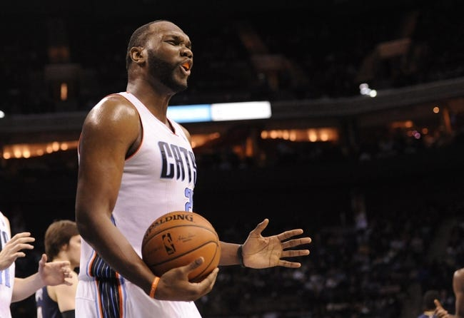 Feb 21, 2014; Charlotte, NC, USA; Charlotte Bobcats center Al Jefferson (25) reacts during the second half against the New Orleans Pelicans at Time Warner Cable Arena. The Bobcats won 90-87. Mandatory Credit: Sam Sharpe-USA TODAY Sports