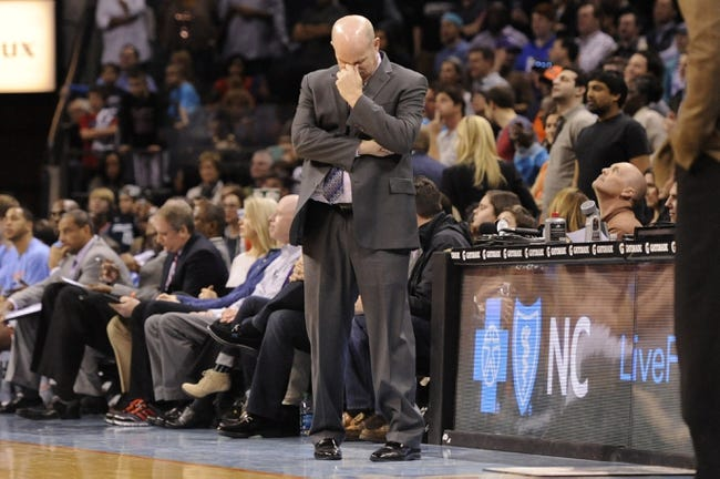 Feb 21, 2014; Charlotte, NC, USA; Charlotte Bobcats head coach Steve Clifford stands on the sidelines against the New Orleans Pelicans during the second half at Time Warner Cable Arena. The Bobcats won 90-87. Mandatory Credit: Sam Sharpe-USA TODAY Sports