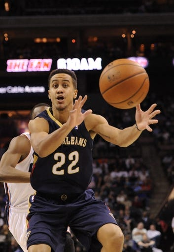 Feb 21, 2014; Charlotte, NC, USA; New Orleans Pelicans guard Brian Roberts (22) catches a pass during the second half of the game against the Charlotte Bobcats  at Time Warner Cable Arena. Bobcats win 90-87. Mandatory Credit: Sam Sharpe-USA TODAY Sports