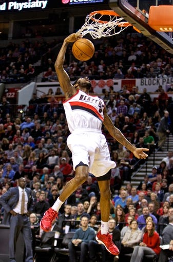 Feb 21, 2014; Portland, OR, USA; Portland Trail Blazers shooting guard Will Barton (5) makes a 360 degree dunk during the second quarter against the Utah Jazz at the Moda Center. Mandatory Credit: Craig Mitchelldyer-USA TODAY Sports