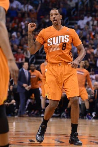 Feb 21, 2014; Phoenix, AZ, USA; Phoenix Suns forward Channing Frye (8) celebrates after scoring against the San Antonio Spurs in the first half at US Airways Center. The Suns won 106-85. Mandatory Credit: Jennifer Stewart-USA TODAY Sports
