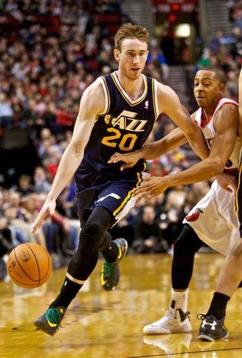 Feb 21, 2014; Portland, OR, USA; Utah Jazz shooting guard Gordon Hayward (20) drives past Portland Trail Blazers shooting guard C.J. McCollum (3) during the third quarter at the Moda Center. Mandatory Credit: Craig Mitchelldyer-USA TODAY Sports