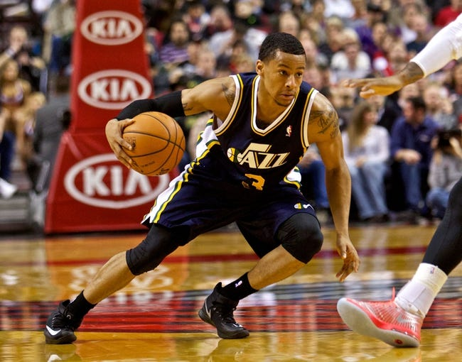 Feb 21, 2014; Portland, OR, USA; Utah Jazz point guard Trey Burke (3) drives to the basket against the Portland Trail Blazers during the third quarter at the Moda Center. Mandatory Credit: Craig Mitchelldyer-USA TODAY Sports