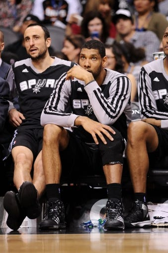 Feb 21, 2014; Phoenix, AZ, USA; San Antonio Spurs forward Tim Duncan (21) sits on the bench in the second half against the Phoenix Suns at US Airways Center. The Suns defeated the Spurs 106-85. Mandatory Credit: Jennifer Stewart-USA TODAY Sports