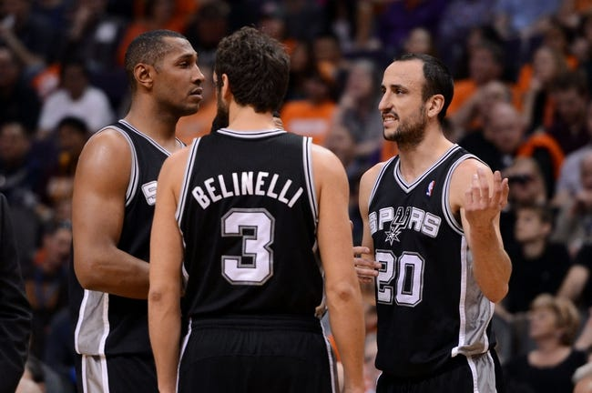 Feb 21, 2014; Phoenix, AZ, USA; San Antonio Spurs guard Manu Ginobili (20) talks with teammates guard Marco Belinelli (3) and forward Boris Diaw (33) in the second half against the Phoenix Suns at US Airways Center. The Suns defeated the Spurs 106-85. Mandatory Credit: Jennifer Stewart-USA TODAY Sports