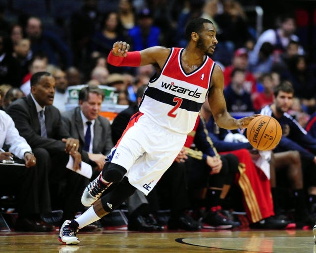 Feb 22, 2014; Washington, DC, USA; Washington Wizards guard John Wall (2) dribbles the ball in the first half against the New Orleans Pelicans at Verizon Center. Mandatory Credit: Evan Habeeb-USA TODAY Sports