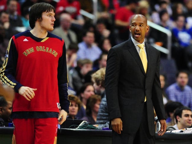 Feb 22, 2014; Washington, DC, USA; New Orleans Pelicans head coach Monty Williams (right) talks to forward Luke Babbit (left) during the game against the Washington Wizards at Verizon Center. Mandatory Credit: Evan Habeeb-USA TODAY Sports