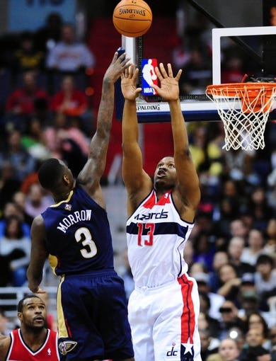 Feb 22, 2014; Washington, DC, USA; New Orleans Pelicans guard Anthony Morrow (3) shoots the ball over Washington Wizards forward Kevin Seraphin (13) at Verizon Center. Mandatory Credit: Evan Habeeb-USA TODAY Sports