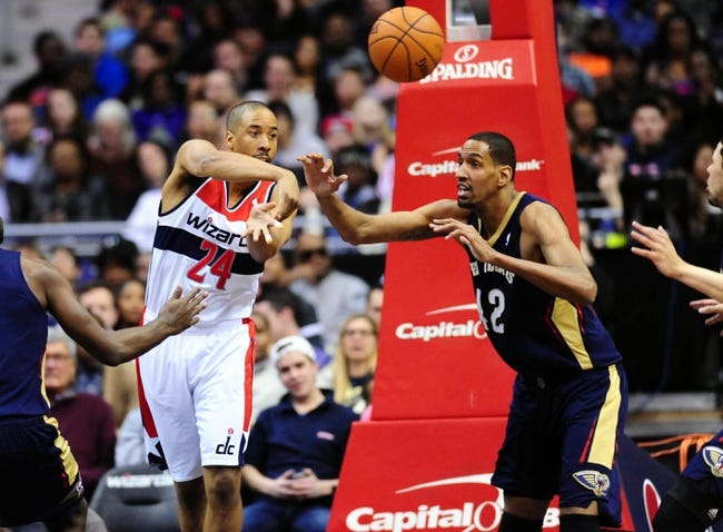 Feb 22, 2014; Washington, DC, USA; Washington Wizards guard Andre Miller (24) passes the ball in front of New Orleans Pelicans center Alexis Ajinca (42) at Verizon Center. Mandatory Credit: Evan Habeeb-USA TODAY Sports