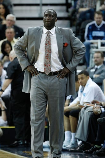 Feb 22, 2014; Salt Lake City, UT, USA; Utah Jazz head coach Tyrone Corbin watches his team play against the Minnesota Timberwolves during the second quarter at EnergySolutions Arena. Mandatory Credit: Chris Nicoll-USA TODAY Sports