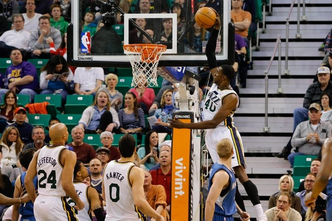 Feb 22, 2014; Salt Lake City, UT, USA; Utah Jazz small forward Jeremy Evans (40) slams the ball into the basket against the Minnesota Timberwolves during the second quarter at EnergySolutions Arena. Mandatory Credit: Chris Nicoll-USA TODAY Sports