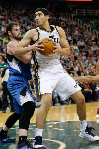 Feb 22, 2014; Salt Lake City, UT, USA; Utah Jazz center Enes Kanter (0) looks to the basket while being guarded by Minnesota Timberwolves power forward Kevin Love (42) during the third quarter at EnergySolutions Arena. Minnesota Timberwolves beat the Utah Jazz 121-104.  Mandatory Credit: Chris Nicoll-USA TODAY Sports