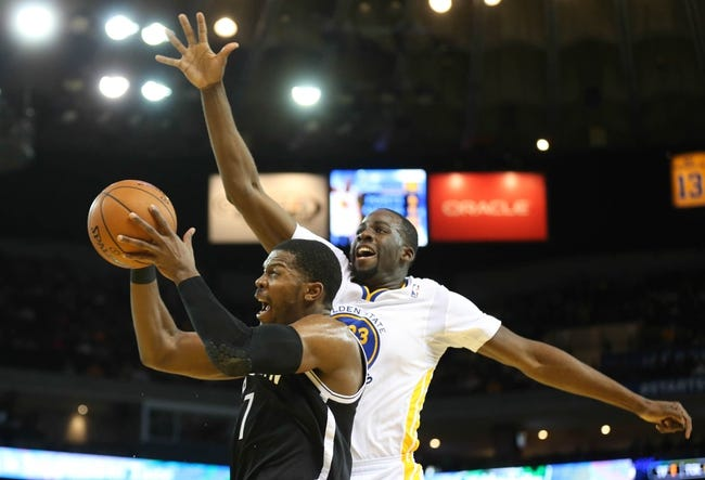 Feb 22, 2014; Oakland, CA, USA; Brooklyn Nets shooting guard Joe Johnson (7) shoots the ball against Golden State Warriors small forward Draymond Green (23) during the first quarter at Oracle Arena. Mandatory Credit: Kelley L Cox-USA TODAY Sports