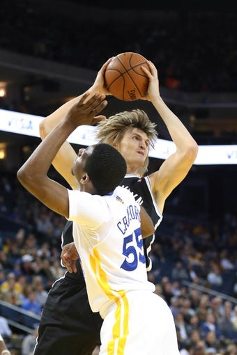Feb 22, 2014; Oakland, CA, USA; Brooklyn Nets small forward Andrei Kirilenko (47) controls the ball against Golden State Warriors shooting guard Jordan Crawford (55) during the second quarter at Oracle Arena. Mandatory Credit: Kelley L Cox-USA TODAY Sports