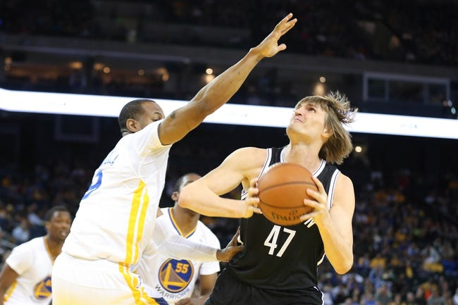 Feb 22, 2014; Oakland, CA, USA; Brooklyn Nets small forward Andrei Kirilenko (47) looks to the basket against Golden State Warriors small forward Andre Iguodala (9) during the second quarter at Oracle Arena. Mandatory Credit: Kelley L Cox-USA TODAY Sports