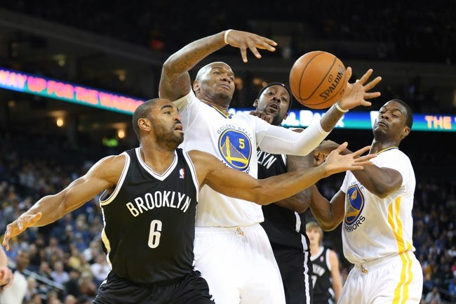 Feb 22, 2014; Oakland, CA, USA; Brooklyn Nets small forward Alan Anderson (6), Golden State Warriors power forward Marreese Speights (5), Brooklyn Nets center Andray Blatche (0) and Golden State Warriors small forward Harrison Barnes (40) battle for a loose ball during the second quarter at Oracle Arena. Mandatory Credit: Kelley L Cox-USA TODAY Sports