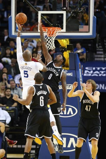 Feb 22, 2014; Oakland, CA, USA; Golden State Warriors power forward Marreese Speights (5) goes up for a shot against Brooklyn Nets center Andray Blatche (0) during the second quarter at Oracle Arena. Mandatory Credit: Kelley L Cox-USA TODAY Sports