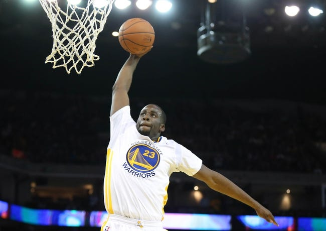 Feb 22, 2014; Oakland, CA, USA; Golden State Warriors small forward Draymond Green (23) dunks the ball against the Brooklyn Nets during the fourth quarter at Oracle Arena. The Golden State Warriors defeated the Brooklyn Nets 93-86. Mandatory Credit: Kelley L Cox-USA TODAY Sports
