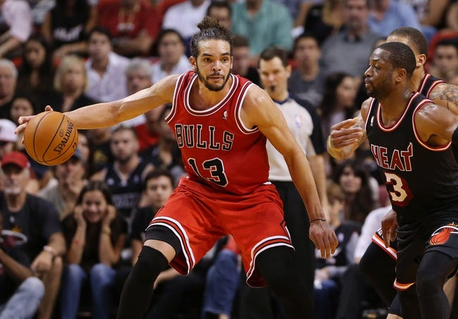 Feb 23, 2014; Miami, FL, USA;  Chicago Bulls center Joakim Noah (13) is defended by Miami Heat shooting guard Dwyane Wade (3) in the second half at American Airlines Arena.The Heat won 93-79.  Mandatory Credit: Robert Mayer-USA TODAY Sports