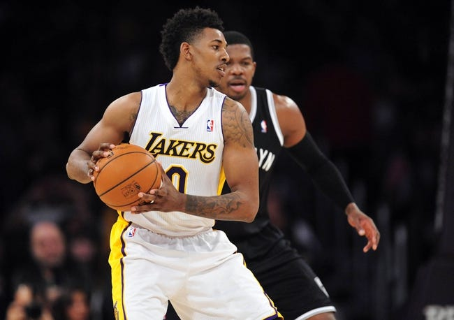 February 23, 2014; Los Angeles, CA, USA; Los Angeles Lakers small forward Nick Young (0) controls the ball  against the Brooklyn Nets during the first half at Staples Center. Mandatory Credit: Gary A. Vasquez-USA TODAY Sports