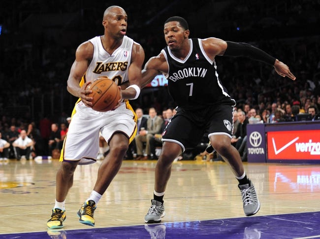 February 23, 2014; Los Angeles, CA, USA; Los Angeles Lakers shooting guard Jodie Meeks (20) moves to the basket against Brooklyn Nets shooting guard Joe Johnson (7) during the second half at Staples Center. Mandatory Credit: Gary A. Vasquez-USA TODAY Sports