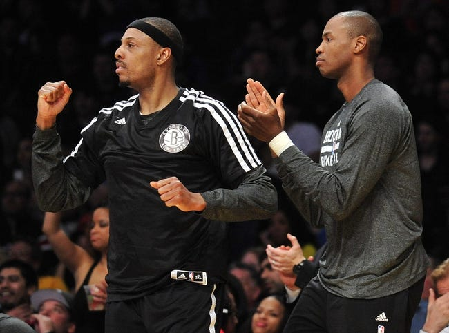 February 23, 2014; Los Angeles, CA, USA; Brooklyn Nets small forward Paul Pierce (34) and center Jason Collins (46) watch game action against the Los Angeles Lakers during the second half at Staples Center. Mandatory Credit: Gary A. Vasquez-USA TODAY Sports