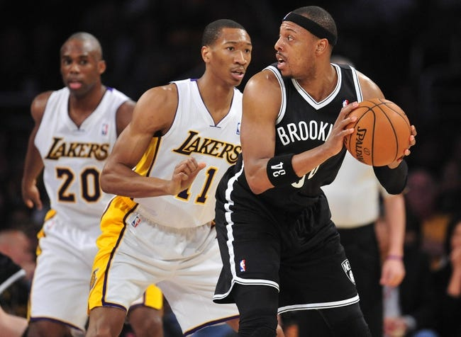 February 23, 2014; Los Angeles, CA, USA; Brooklyn Nets small forward Paul Pierce (34) controls the ball against the Los Angeles Lakers during the second half at Staples Center. Mandatory Credit: Gary A. Vasquez-USA TODAY Sports