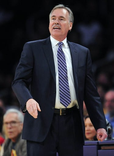 February 23, 2014; Los Angeles, CA, USA; Los Angeles Lakers head coach Mike D'Antoni watches game action against the Brooklyn Nets during the first half at Staples Center. Mandatory Credit: Gary A. Vasquez-USA TODAY Sports