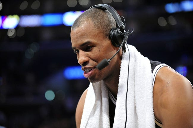 February 23, 2014; Los Angeles, CA, USA; Brooklyn Nets center Jason Collins conducts a radio interview following the 108-102 victory against the Los Angeles Lakers at Staples Center. Mandatory Credit: Gary A. Vasquez-USA TODAY Sports