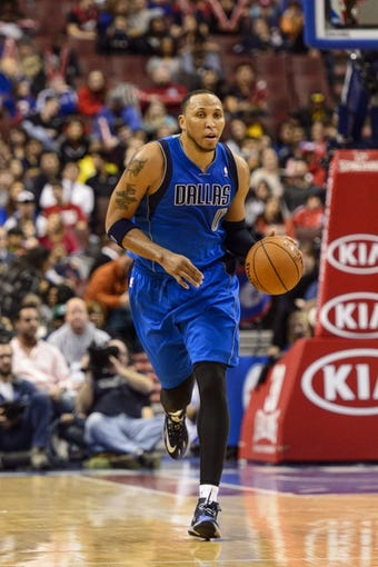 Feb 21, 2014; Philadelphia, PA, USA; Dallas Mavericks forward Shawn Marion (0) brings the ball up court during the second quarter against the Philadelphia 76ers at the Wells Fargo Center. The Mavericks defeated the Sixers 124-112. Mandatory Credit: Howard Smith-USA TODAY Sports