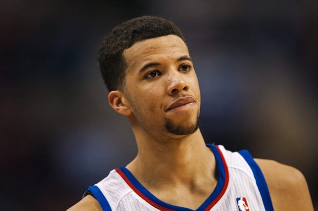 Feb 21, 2014; Philadelphia, PA, USA; Philadelphia 76ers guard Michael Carter-Williams (1) during the fourth quarter against the Dallas Mavericks at the Wells Fargo Center. The Mavericks defeated the Sixers 124-112. Mandatory Credit: Howard Smith-USA TODAY Sports