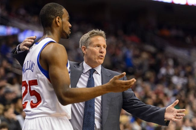 Feb 21, 2014; Philadelphia, PA, USA; Philadelphia 76ers head coach Brett Brown talks with guard Elliot Williams (25) during the third quarter against the Dallas Mavericks at the Wells Fargo Center. The Mavericks defeated the Sixers 124-112. Mandatory Credit: Howard Smith-USA TODAY Sports