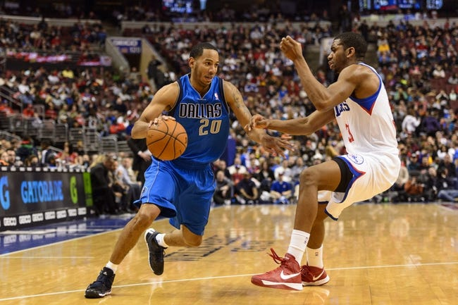 Feb 21, 2014; Philadelphia, PA, USA; Dallas Mavericks guard Devin Harris (20) is defended by Philadelphia 76ers forward Hollis Thompson (31) during the third quarter at the Wells Fargo Center. The Mavericks defeated the Sixers 124-112. Mandatory Credit: Howard Smith-USA TODAY Sports