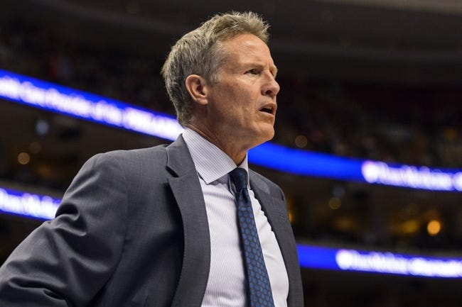 Feb 21, 2014; Philadelphia, PA, USA; Philadelphia 76ers head coach Brett Brown watches the game during the third quarter against the Dallas Mavericks at the Wells Fargo Center. The Mavericks defeated the Sixers 124-112. Mandatory Credit: Howard Smith-USA TODAY Sports