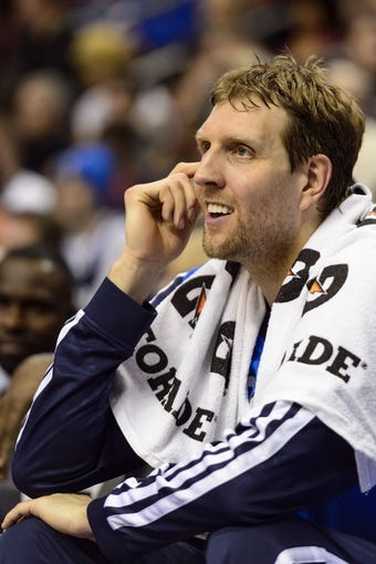Feb 21, 2014; Philadelphia, PA, USA; Dallas Mavericks forward Dirk Nowitzki (41) watches from the bench during the fourth quarter against the Philadelphia 76ers at the Wells Fargo Center. The Mavericks defeated the Sixers 124-112. Mandatory Credit: Howard Smith-USA TODAY Sports