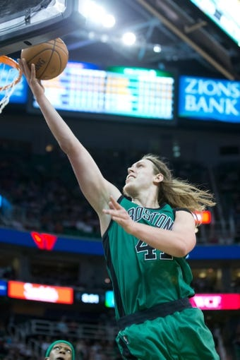 Feb 24, 2014; Salt Lake City, UT, USA; Boston Celtics center Kelly Olynyk (41) shoots the ball during the first half against the Utah Jazz at EnergySolutions Arena. Mandatory Credit: Russ Isabella-USA TODAY Sports
