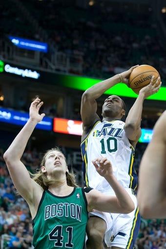 Feb 24, 2014; Salt Lake City, UT, USA; Utah Jazz point guard Alec Burks (10) shoots the ball over Boston Celtics center Kelly Olynyk (41) during the second half at EnergySolutions Arena. The Jazz won 110-98. Mandatory Credit: Russ Isabella-USA TODAY Sports