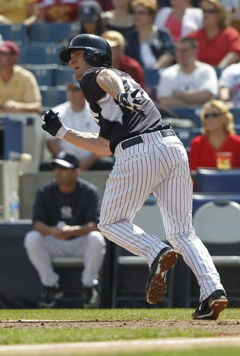 Feb 25, 2014; Tampa, FL, USA; New York Yankees shortstop Brendan Ryan (17) hits a RBI single during the second inning against the  Florida State Seminoles at George M. Steinbrenner Field. Mandatory Credit: Kim Klement-USA TODAY Sports