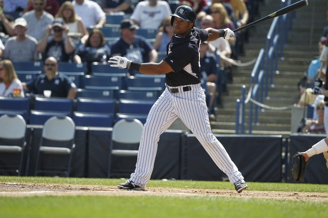 Feb 25, 2014; Tampa, FL, USA; New York Yankees left fielder Zoilo Almonte (65) doubles during the second inning against the Florida State Seminoles at George M. Steinbrenner Field. Mandatory Credit: Kim Klement-USA TODAY Sports