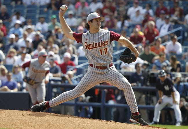 Feb 25, 2014; Tampa, FL, USA;  Florida State Seminoles starting pitcher Mike Compton (17) throws a pitch against the New York Yankees at George M. Steinbrenner Field. Mandatory Credit: Kim Klement-USA TODAY Sports