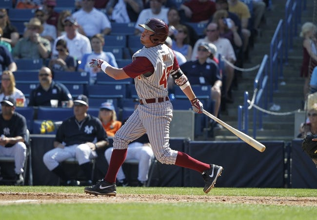 Feb 25, 2014; Tampa, FL, USA; Florida State Seminoles infielder Casey Smit (43) hits a 3-RBI double during the sixth inning against the New York Yankees at George M. Steinbrenner Field. Mandatory Credit: Kim Klement-USA TODAY Sports