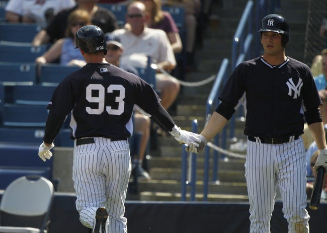 Feb 25, 2014; Tampa, FL, USA; New York Yankees shortstop Dean Anna (93) scores a run and high fives New York Yankees catcher John Ryan Murphy (66) after he scored a run during the fourth inning against the Florida State Seminoles pitcher Brandon Johnson (51) at George M. Steinbrenner Field. Mandatory Credit: Kim Klement-USA TODAY Sports