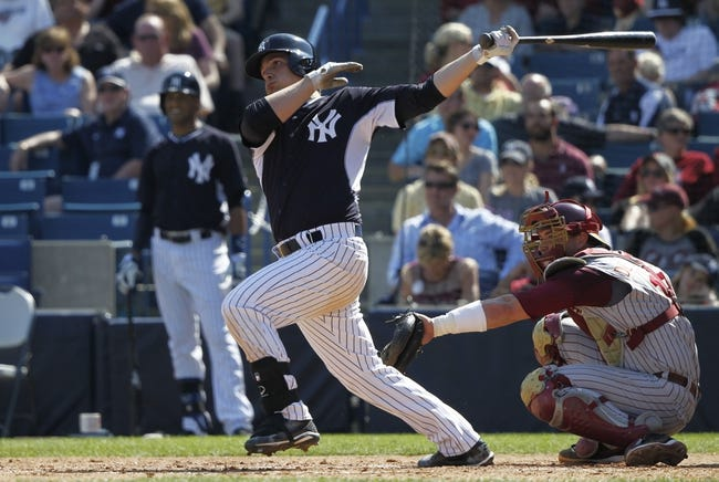 Feb 25, 2014; Tampa, FL, USA; New York Yankees catcher John Ryan Murphy (66) hits a RBI double in foruth inning against the Florida State Seminoles at George M. Steinbrenner Field. Mandatory Credit: Kim Klement-USA TODAY Sports