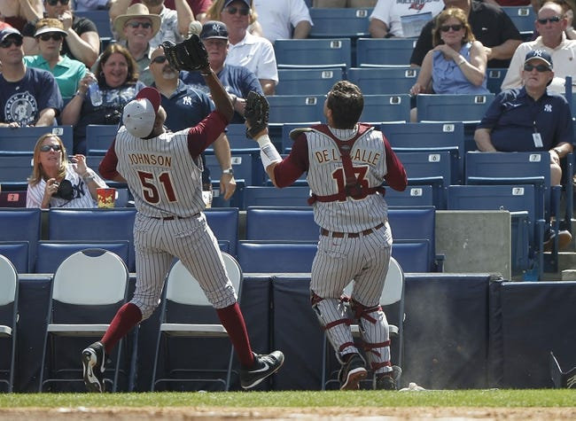 Feb 25, 2014; Tampa, FL, USA;  Florida State Seminoles pitcher Brandon Johnson (51) catches a foul ball for an out during the third inning against the New York Yankees at George M. Steinbrenner Field. Mandatory Credit: Kim Klement-USA TODAY Sports